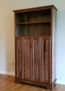 Bookcase with Bi-fold doors and adjustable shelves