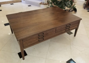 coffee table with game and puzzle drawers
